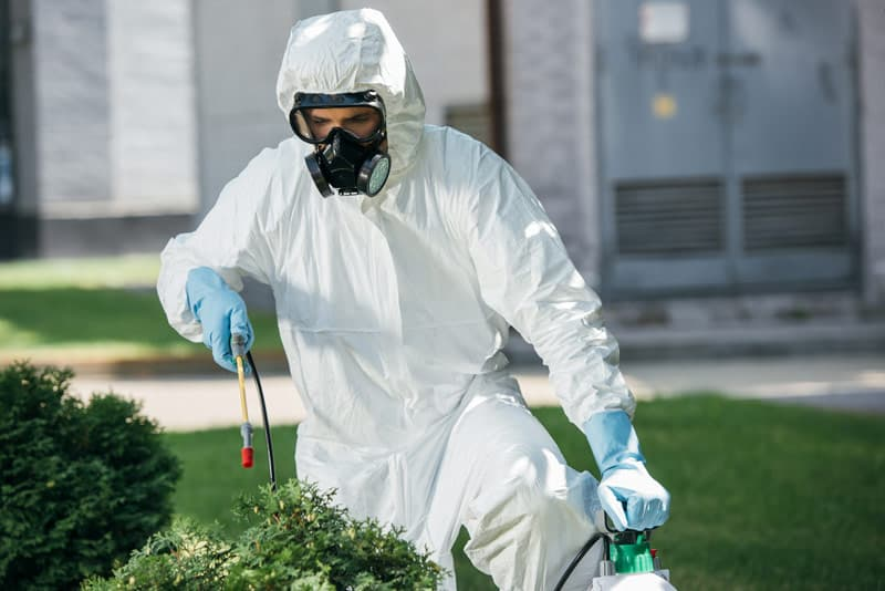 spray merit using protective clothing