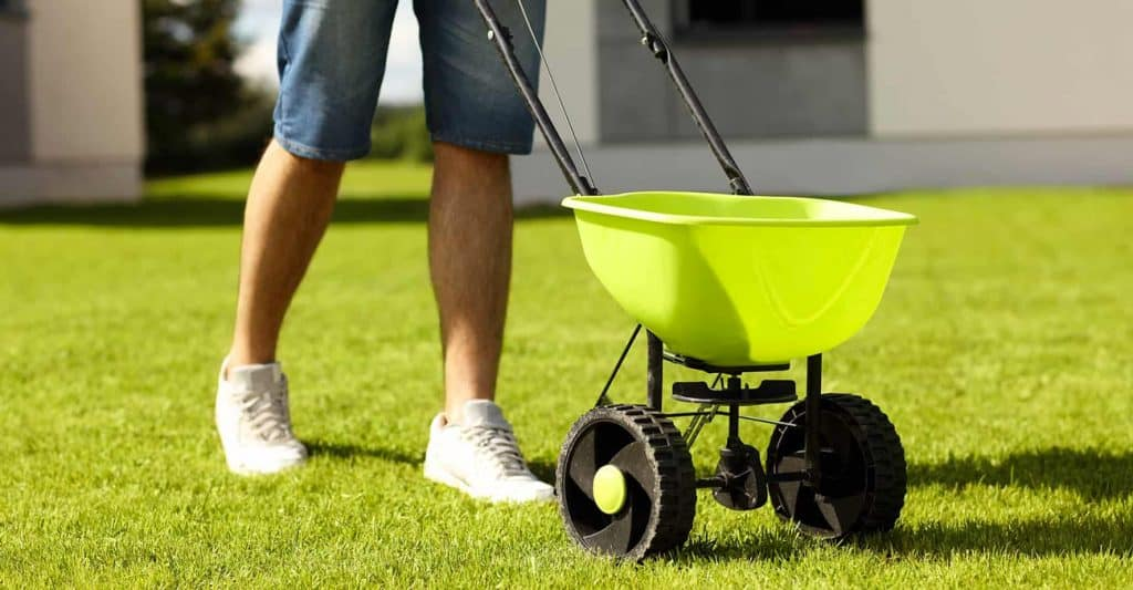 use a lawn spreader to apply bifen granules